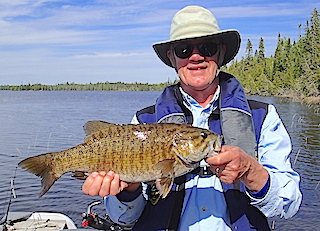 Great Trophy Smallmouth Bass fishing at Fireside Lodge in Canada by Paul